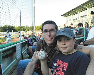 Avery Motzko with his Dad, Garrett Motzko enjoyed a Scrapper's game in 2012.  Sent by Avery's  grandma and Garrett's mom, Sharon Landis of Warren. This is one of his favorite memories and treasured pictures.