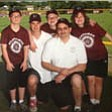 Very special coach and dad Bill Timmerman is shown with his adopted special-needs children in their Challenger baseball picture. Sent by mom, Sandee Timmerman.