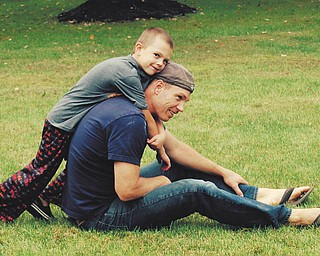 Ryan Ward: Andy Ward, 6, and his dad Ryan Ward, enjoyed a rare quiet moment together in their front yard in Poland. Sent by Jennifer Ward.