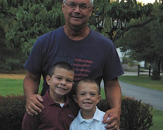 Proud Papa Ken Tirpack of Boardman with his grandsons, Gavin Ward, 8, and Andy Ward, 6, both of Poland, are ready for the first day of school at St. Charles in 2013. Sent by Jen Ward.
