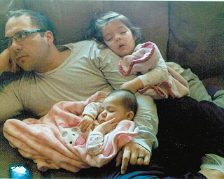 Dan Schiavoni chilling with his daughters, Kaylea and Carmella. Sent by Dan's mother, Joan Schiavoni of Boardman.