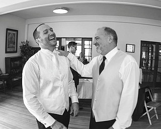 David and Dante DiRusso sharing a laugh at Dante's wedding.