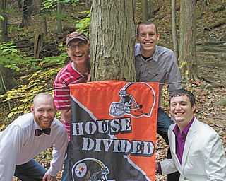 A family divided: Brian, Travis and Tyler Denmeade are Browns fans and Joshua Denmeade is the Steelers fan.