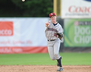 JAMESTOWN, NEW YORK - JUNE 13, 2014: Infielder Austin Fisher #12 of the Scrappers throws the ball to first base for the second out in the top of the 3rd inning during a game at Russell Diethrick Park. (Photo by David Dermer/Youngstown Vindicator)