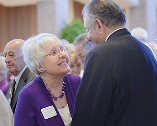 Maryann Jurcisin smiles at her husband, Jerry, as they repeat their wedding vows that they made 55 years ago. They were among the 131 couples who were honored during Sunday's Wedding Anniversary Celebration at St. Columba Cathedral.