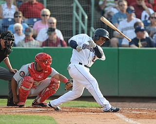 NILES, OHIO - JUNE 17, 2014: Batter Francisco Mejia #27 of the Scrappers loses the grip of his bat while swinging it in the bottom of the 2nd inning during Tuesday nights New York Penn League game at Eastwood Field. (Photo by David Dermer/Youngstown Vindicator)
