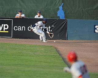 NILES, OHIO - JUNE 17, 2014: Outfielder D'Vone McClure #1 of the Scrappers chases down the ball in the corner while base runner Cody Gunter #10 of the Double days runs to second base for a double in the top of the 4th inning during Tuesday nights New York Penn League game at Eastwood Field. (Photo by David Dermer/Youngstown Vindicator)