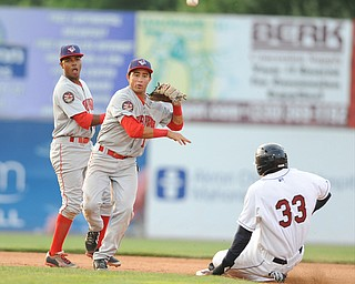 NILES, OHIO - JUNE 17, 2014: Infielder Bryan Mejia #1 of the Doubledays throws the ball to first base to turn a double play after stepping on second to force out base runner Jorge martinez #33 of the Scrappers in the bottom of the 5th inning during Tuesday nights New York Penn League game at Eastwood Field. (Photo by David Dermer/Youngstown Vindicator) Infielder Osvaldo Abreu #7 pictured.
