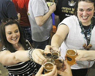 Leanne Nagle, left, of Beaver, Pa., and Kristi Williams of Beaver Falls, Pa., toast with friends during Big Tap In.