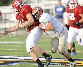 David Dermer   The Vindicator.Mahoning County's running back Nick Pollifrone is tackled by Trumbull County's linebacker Josh Gross during the 2nd quarter of  the Mahoning Valley Coaches Association's Jack Arvin Football Classic Thursday at Hubbard High School.