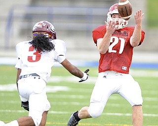 Mahoning County's running back Nick Pollifrone bobbles the ball before being hit by Trumbull County's defensive back Daquan Carter  during the 2nd quarter of the Mahoning Valley Coaches Association's Jack Arvin Football Classic Thursday at Hubbard High School.