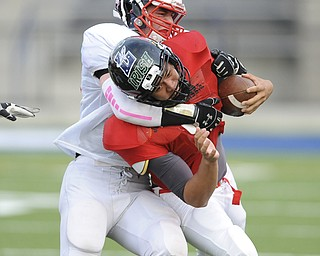 David Dermer | The Vindicator.Mahoning County's running back Kimu Kim is wrapped up by Trumbull County's linebacker Nick Sanchez during the 3rd quarter of the Mahoning Valley Coaches Association's Jack Arvin Football Classic Thursday at Hubbard High School.