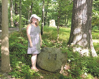 Dorothy Butler of Youngstown stands next to the rock that displayed the Butler family plaque in Poland Municipal