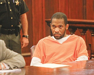 Aubrey Toney stares as he is sentenced Thursday in Mahoning County Common Pleas Court for the September 2010 murder of Thomas Repchic.
