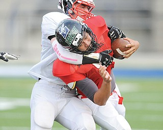 Trumbull's Nick Sanchez of Niles stops Mahoning-Columbiana's Kimu Kim of Canfield in the third quarter of the Thursday's MVCA's all-star football game in Hubbard. Trumbull won 27-15.