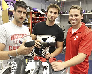 William D Lewis|The Vindicator  Making plans for the benefit hockey game for Dean Macklen are, from left, Adam Chudnofsky, Kristopher Johnson and Christopher Wilkinson.