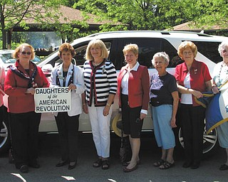 SPECIAL TO THE VINDICATOR The Mary Chesney Chapter of the National Society Daughters of the American Revolution participated in the Memorial Day parade in Warren. From left are Marilyn Kegarise, Janice Powell Hill, Carol Noga, Patty Brandes, Janet Sweitzer, Pauline Boye, Mary Barson and Roberta Davis.