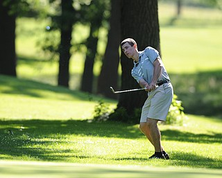 HERMITAGE, PENNSYLVANIA - JUNE 20, 2014: Vincent Leone of Canfield chips his ball from the short rough to the green on the 1st hole Friday morning at Tam O'Shanter golf course during the Vindy Greatest Golfer tournament. (Photo by David Dermer/Youngstown Vindicator)