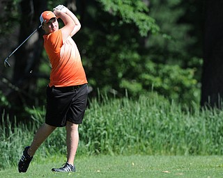 HERMITAGE, PENNSYLVANIA - JUNE 20, 2014: Cameron Gumble of Austintown follows through with his tee shot on the 2nd hole Friday morning at Tam O'Shanter golf course during the Vindy Greatest Golfer tournament. (Photo by David Dermer/Youngstown Vindicator)