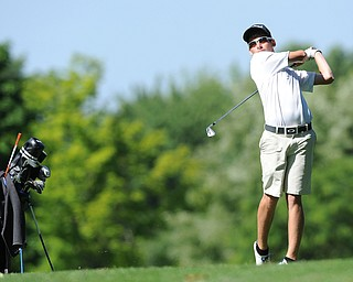 HERMITAGE, PENNSYLVANIA - JUNE 20, 2014: Brian Velasquezof Poland follows through with his tee shot on the 5th hole Friday morning at Tam O'Shanter golf course during the Vindy Greatest Golfer tournament. (Photo by David Dermer/Youngstown Vindicator)