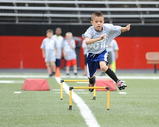 YOUNGSTOWN, OHIO - JUNE 21, 2014: Jordan Valdez clears a hurdle during the Brad Smith Football Camp at Stambaugh Stadium on the campus of Youngstown State Saturday morning. (Photo by David Dermer/Youngstown Vindicator)