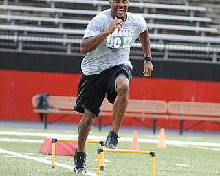 YOUNGSTOWN, OHIO - JUNE 21, 2014: Brad Smith clears a hurdle during a drill during the Brad Smith Football Camp at Stambaugh Stadium on the campus of Youngstown State Saturday morning. (Photo by David Dermer/Youngstown Vindicator)