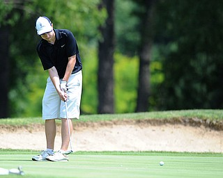 SALEM, OHIO - JUNE 23, 2014: Alec Hamilton of Austintown follows though on his putt  on the 15th hole on Monday afternoon at the Salem Golf Club during the Vindy Greatest Golfer tournament. (Photo by David Dermer/Youngstown Vindicator)