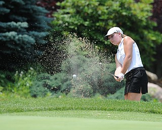SALEM, OHIO - JUNE 23, 2014: Nicolette Eddy of Kennedy chips her ball out of the bunker on the 12th hole on Monday afternoon at the Salem Golf Club during the Vindy Greatest Golfer tournament. (Photo by David Dermer/Youngstown Vindicator)