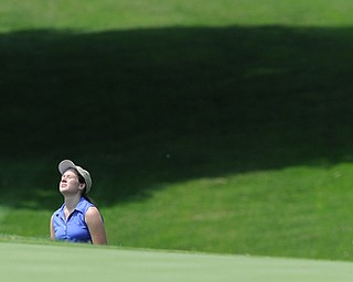 SALEM, OHIO - JUNE 23, 2014: Rachel Russell of Howland reacts after a bad shot and failing to get onto the green out of the bunker Monday afternoon at the Salem Golf Club during the Vindy Greatest Golfer tournament. (Photo by David Dermer/Youngstown Vindicator)