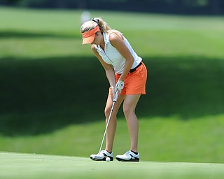 SALEM, OHIO - JUNE 23, 2014: Alexa Tringhese of Columbiana follows through on her putt on Monday afternoon at the Salem Golf Club during the Vindy Greatest Golfer tournament. (Photo by David Dermer/Youngstown Vindicator)