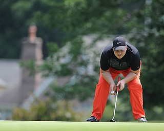 SALEM, OHIO - JUNE 23, 2014: Cameron Gumble of Austintown examines the green before his shot on the 15th hole on Monday afternoon at the Salem Golf Club during the Vindy Greatest Golfer tournament. (Photo by David Dermer/Youngstown Vindicator)