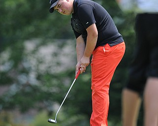 SALEM, OHIO - JUNE 23, 2014: Cameron Gumble of Austintown follows though on his putt on the 15th hole on Monday afternoon at the Salem Golf Club during the Vindy Greatest Golfer tournament. (Photo by David Dermer/Youngstown Vindicator)