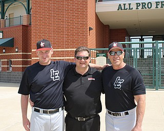 Lake Erie Crushers general manager Rick Muntean, center, a Youngstown native, stands with Crushers manager Chris Mangiardo, left, and hitting coach Joe Charboneau Crushers outside All Pro Feight Stadium in Erie, Pa. Muntean, a Wilson graduate, has been involved in minor league baseball for 32 years.