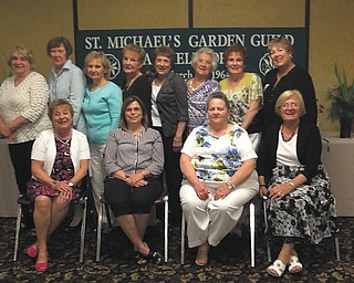 St. Michael Garden Guild of Canfield recently celebrated its 50th Anniversary Flower Show. The following members received blue ribbons at the event, which took place in the parish hall. From left, sitting, are Janet Murray, Debbie Sulenski, Mary Ann Silvestri and Liz Rehlinger; and standing are Marilyn Chui, Kaaren Cabraja, Carol Cartwright, Cookie Beeman, Doe Gallagher, Pat Hoyle, Kaye Smith and Mag Mitchell. SPECIAL TO THE VINDICATOR