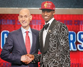 NBA Commissioner Adam Silver congratulates former Kansas forward Andrew Wiggins after Wiggins was selected as the No. 1 pick by the Cleveland Cavaliers in the 2014 NBA draft Thursday at The Barclays Center in Brooklyn, N.Y.