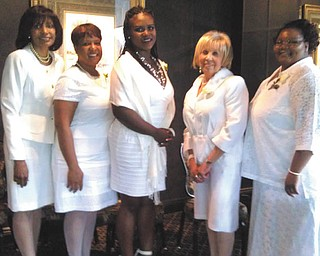 The Links inductees, above, were required to attend orientation workshops and pass a 