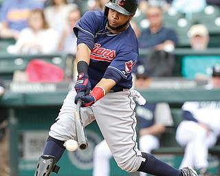 Indians designated hitter Carlos Santana breaks his bat as he grounds out against the Mariners on Sunday in