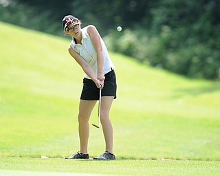 CANFIELD, OHIO - JUNE 30, 2014: Emily Koehler of Vienna chips her ball from the fairway to the green on the 8th hole Monday morning at Diamondback Golf Course during the Vindy Greatest Golfer of the Valley tournament. (Photo by David Dermer/Youngstown Vindicator)