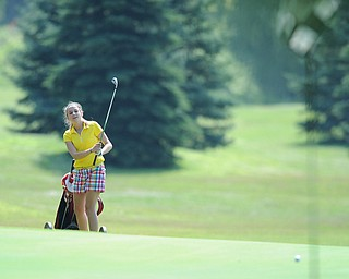 CANFIELD, OHIO - JUNE 30, 2014: Ally Moreschi of Columbiana smiles while watching her ball break away from the hole after a chip shot on the 7th hole Monday morning at Diamondback Golf Course during the Vindy Greatest Golfer of the Valley tournament. (Photo by David Dermer/Youngstown Vindicator)