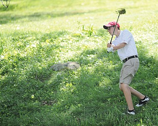 Daniel Lapolla of Warren shoots out of the long rough on the ninth hole on Tuesday at Diamondback golf course