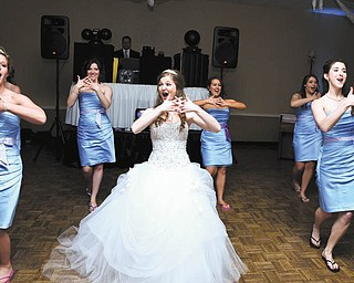 On May 25 at the Turek-Brown wedding, bride and bridesmaids choreographed and performed a dance for the groom and groomsmen. They are Janice Abrams of North Royalton, Elysia Shutrump of NYC, the bride, Kayla Turek Brown, Courtney Larson of Canfield, Lynnette Enterline of Boardman and Lauren Walker of Northport, Ala. The reception was held at the Embassy. Submitted by the bride's mother, Sally Turek of Canfield.