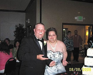 This is Mike and Lisa Kuty at their wedding reception, Aug. 8, 2009. Sent by Lisa of Girard.