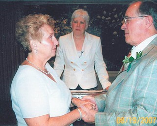 Don and June Hoelzel of Poland with the Rev. Ann Miller at their wedding Aug. 19, 2007. They met at the Canfield Fair in 2006 while both were volunteering.