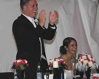 Patty Crago, the bride's mother, took this picture when the best man, Dunn, sang a song he wrote for the couple as his speech as best man. The couple are Jeneane and Brent Hugus, who celebrated their fifth wedding anniversary June 20. All live in Canfield.