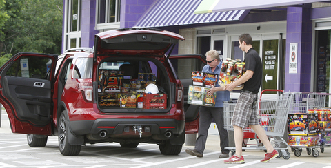 Gaven Hedrick of Erie, Pa., heads to his car at Phantom Fireworks in Youngstown with Dave Phelan, assistant store manager.