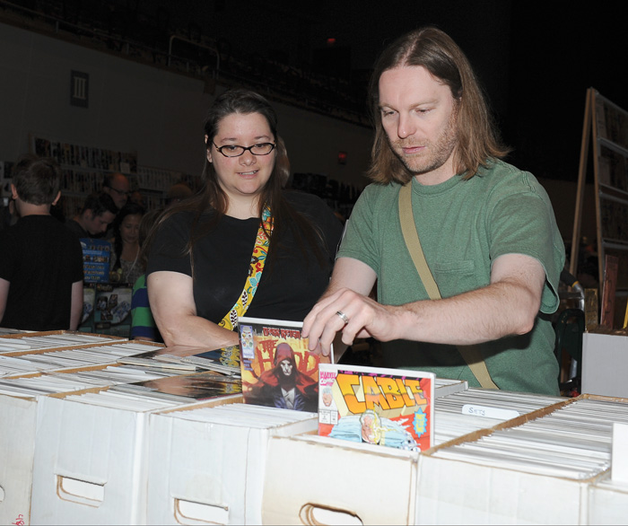 Eric Harper and Julie Cancio-Harper, both of Boardman, look through stacks of comic books at the fifth annual comic-book convention.