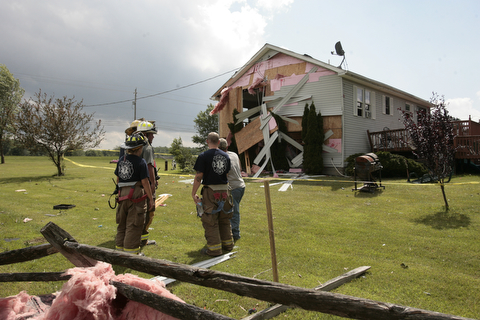 ROBERT K. YOSAY  | THE VINDICATOR...A house had its roofing blown off and a side wall blown out by the storm on 9000 block of Canfield Akron Rd (224) .a small structure of the neighbors used for students waiting on a bus was destroyed ...  -30-