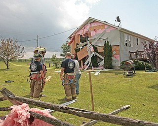 A house had an entire side blown off , and damage to the roof caused ceilings to cave into the home on the 9300 block of Akron-Canfield Road in Ellsworth Township on Tuesday afternoon. The storm went through the townships of Ellsworth and Canfield as well as the city of Canfield.