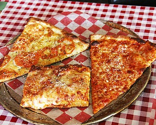 Time-tested family recipes are used for both the tomato sauce and dough used for the Italian Village's variety of pizzas. Patrons can choose a thin crust or a thick Sicilian crust.