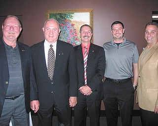 Officers for the Rotary Club of Austintown were installed recently for the 2014-2015 year. Above, from left to right, are Chuck Baker, who installed the officers; Mal Culp, president elect; John Mashiska, chairman of vocational service; Richard Begalla, chairman of international service; and Vince Colaluca, president. Below, from left to right, are Ed Kalaher, chairman of club service; Heather Fronk, chairwoman of community service; Tracie Kaglic, secretary; and Baker.